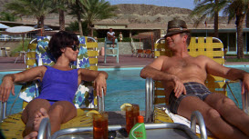 1960s couple chatting and sunbathing by pool 766-18